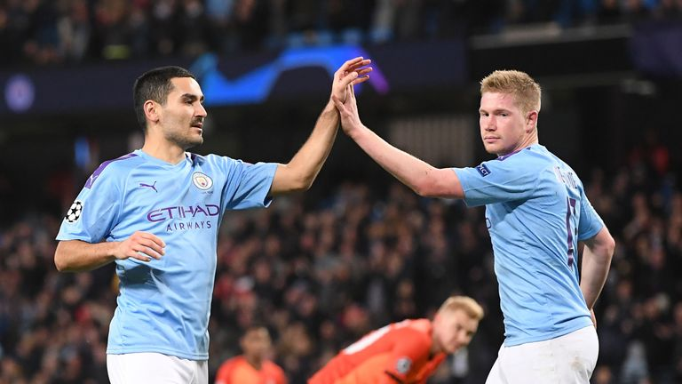 Ilkay Gundogan of Manchester City celebrates with teammate Kevin De Bruyne after scoring his team's first goal during the UEFA Champions League group C match between Manchester City and Shakhtar Donetsk at Etihad Stadium