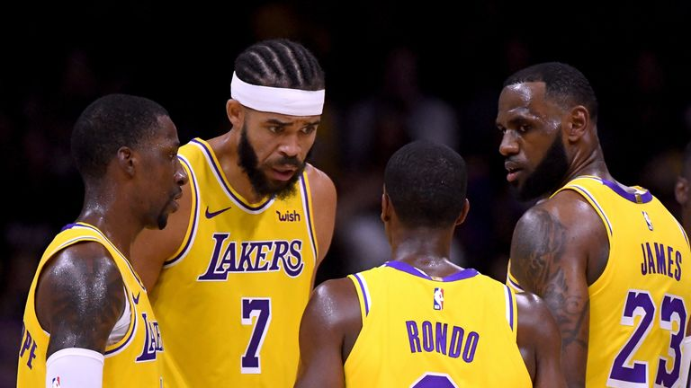 Javale McGee, Rajon Rondo and LeBron James in discussion during a preseason game