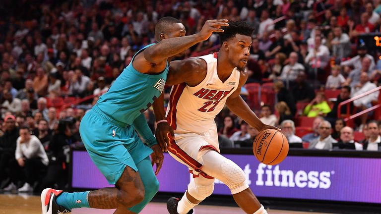 Jimmy Butler #22 of the Miami Heat drives to the basket against the Charlotte Hornets in the second half at American Airlines Arena on November 25, 2019 in Miami, Florida.