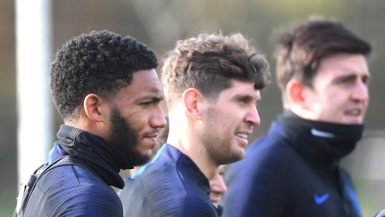 Joe Gomez is pictured with John Stones and Harry Maguire during England training