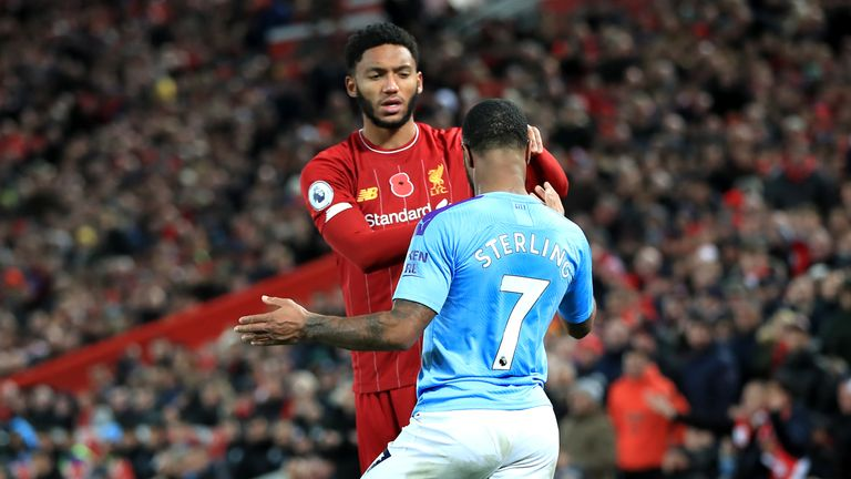 Joe Gomez and Raheem Sterling clash during Liverpool vs Manchester City at Anfield