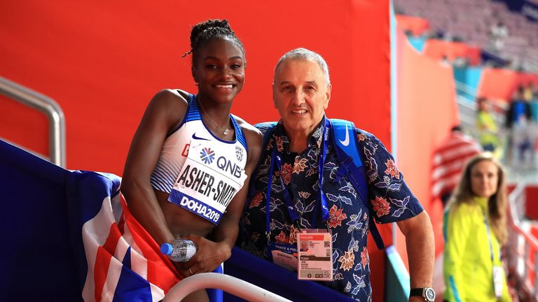 John Blackie and Dina Asher-Smith celebrate her 200m gold medal at the World Championships - © PA