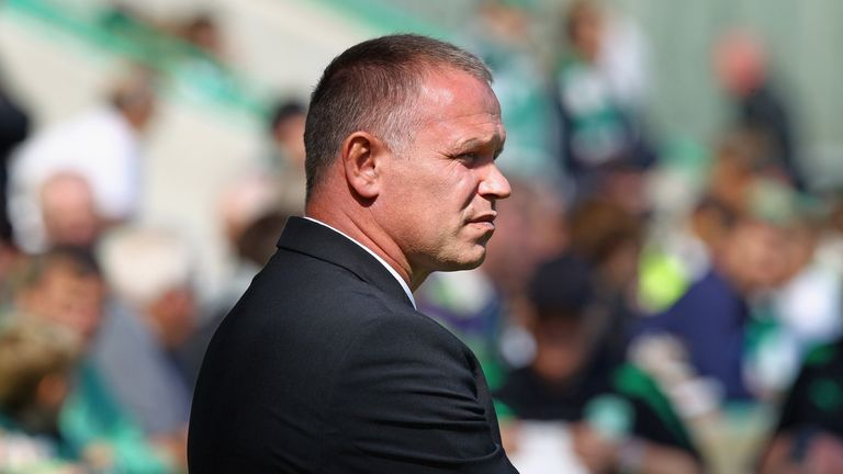 EDINBURGH, SCOTLAND - AUGUST 22:  John Hughes coach of Hibernian reacts during the Clydesdale Bank during the Clydesdale Bank Scottish Premier League match between Hibernian and Rangers at Easter Road stadium on August 22, 2010 in Edinburgh, Scotland.  (Photo by Jeff J Mitchell/Getty Images)