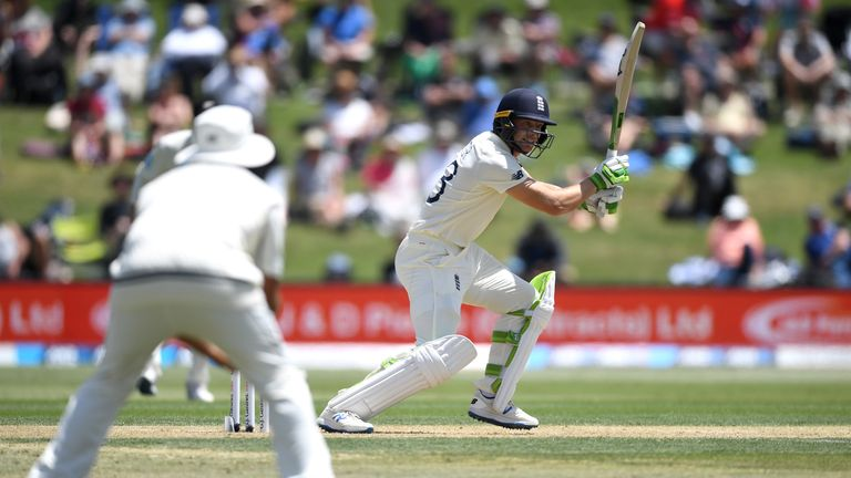 England's Jos Buttler drives on the second day of the first Test against New Zealand
