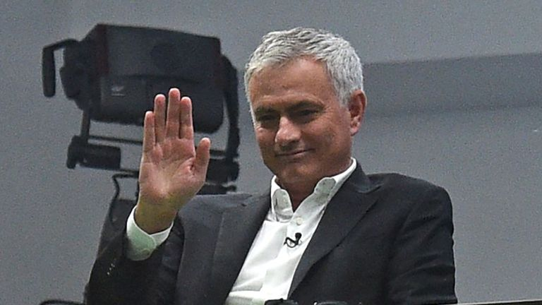 Former manager Jose Mourinho (C) waves to fans from the TV studio during the English Premier League football match between Manchester United and Liverpool at Old Trafford in Manchester, north west England, on October 20, 2019