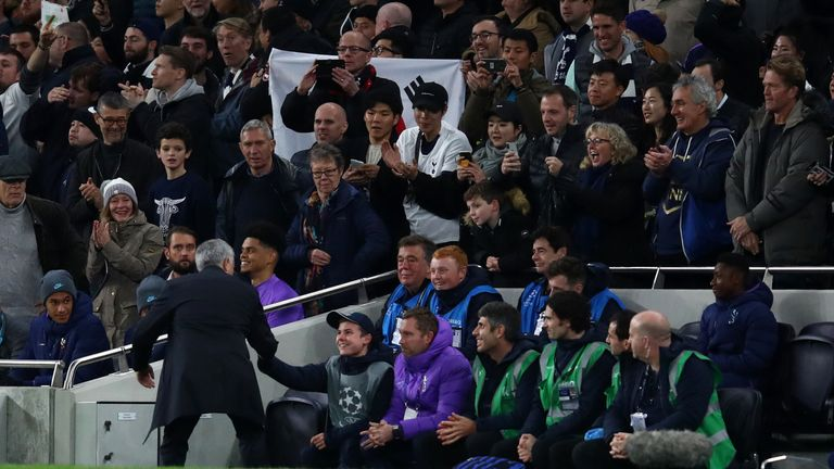 Jose Mourinho, Manager of Tottenham Hotspur shakes hands with a ball boy as he celebrates his team's second goal during the UEFA Champions League group B match between Tottenham Hotspur and Olympiakos FC at Tottenham Hotspur Stadium