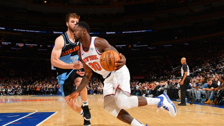 Julius Randle of the New York Knicks drives to the basket against the Cleveland Cavaliers