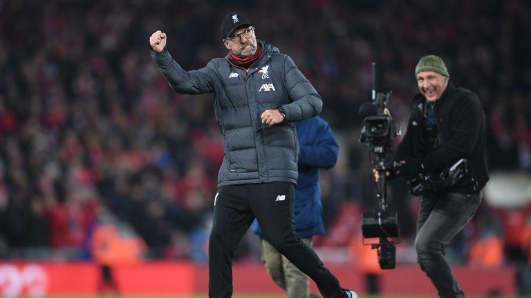 Liverpool boss Jurgen Klopp pumps his fists at full-time at Anfield