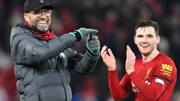Jurgen Klopp celebrates with Andrew Robertson