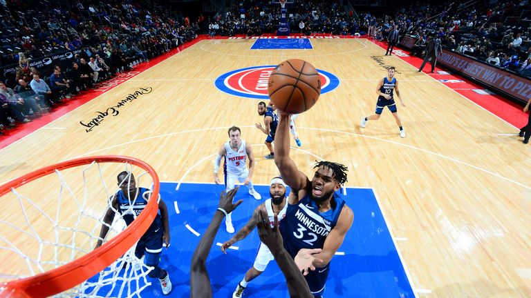Karl-Anthony Towns of the Minnesota Timberwolves shoots the ball against the Detroit Pistons