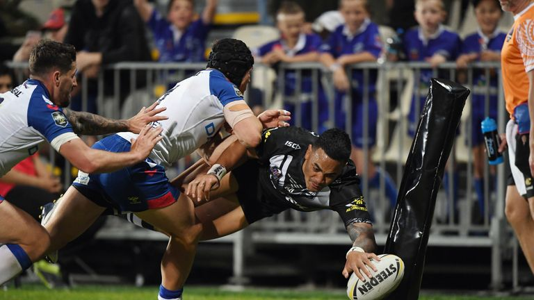 Ken Maumalo dives over to score for New Zealand