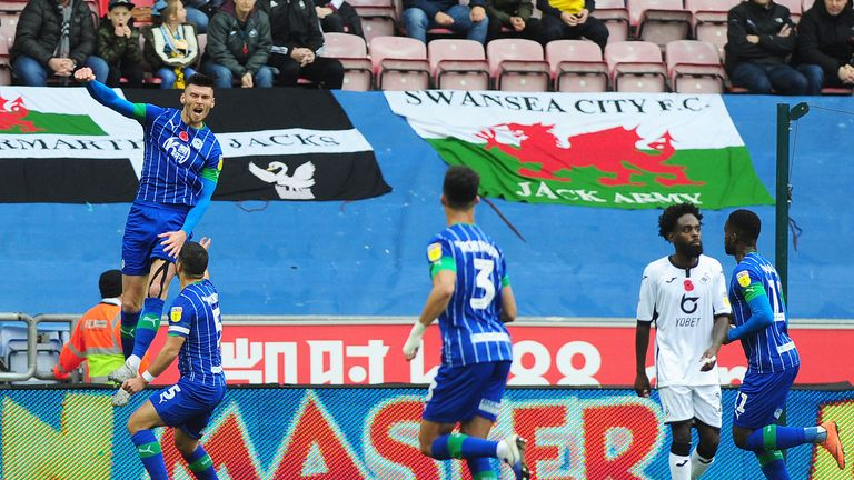Kieffer Moore of Wigan Athletic celebrates scoring his side's equalising goal