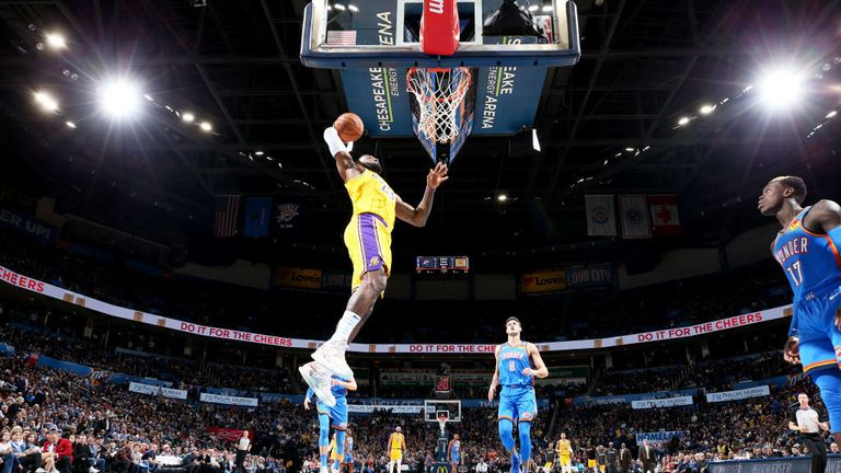 LeBron James #23 of the Los Angeles Lakers dunks the ball during a game against the Oklahoma City Thunder
