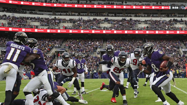 Quarterback Lamar Jackson of the Baltimore Ravens rushes against the Houston Texans