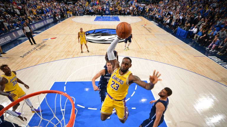 LeBron James  of the Los Angeles Lakers dunks the ball against the Dallas Mavericks