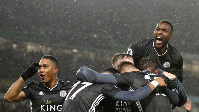 Youri Tielemans, Wes Morgan and team-mates celebrate after Ayoze Perez scores Leicester's first goal