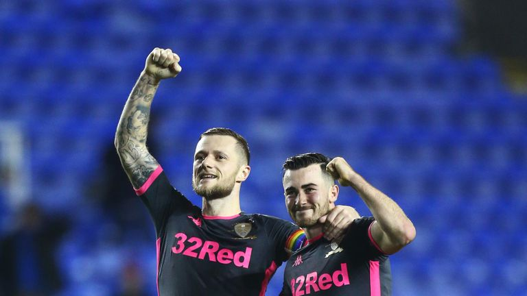 Liam Cooper and Jack Harrison celebrate Leeds' win at Reading