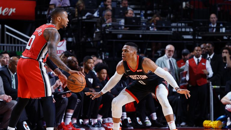 Russell Westbrook of the Houston Rockets plays defense against Damian Lillard of the Portland Trail Blazers