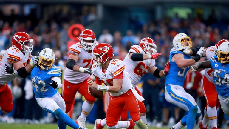 Quarterback Patrick Mahomes of the Kansas City Chiefs scrambles against the defence of the Los Angeles Chargers