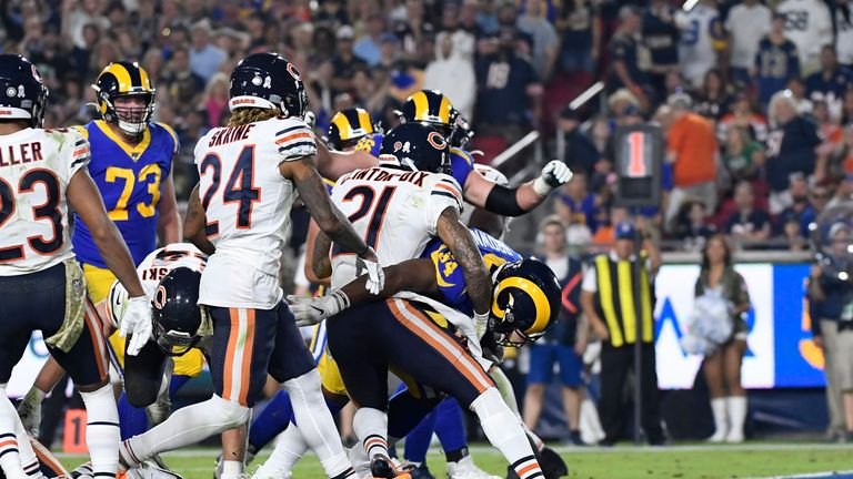 Malcolm Brown of the Los Angeles Rams scores a touchdown against Ha Ha Clinton-Dix of the Chicago Bears