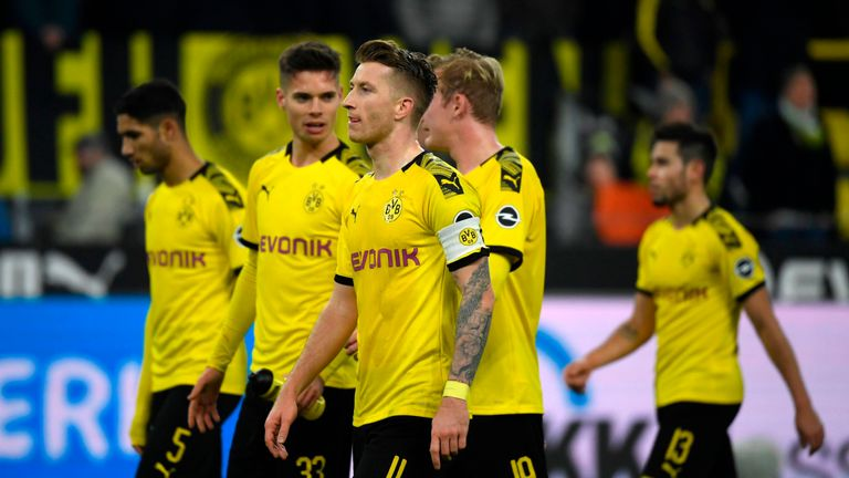Marco Reus scored a last-gasp goal to snatch a point for Borussia Dortmund