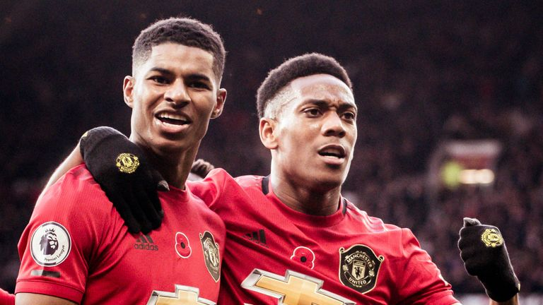 Marcus Rashford celebrates with Anthony Martial after scoring for Manchester United against Brighton
