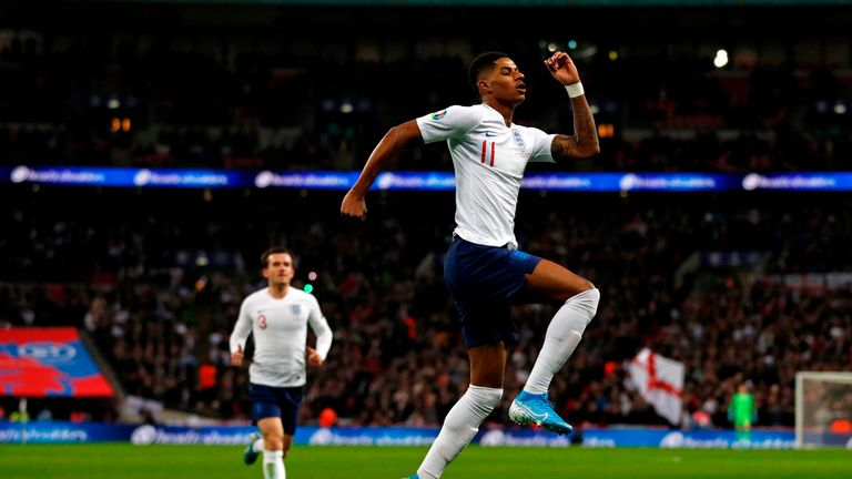 Marcus Rashford celebrates scoring for England against Montenegro
