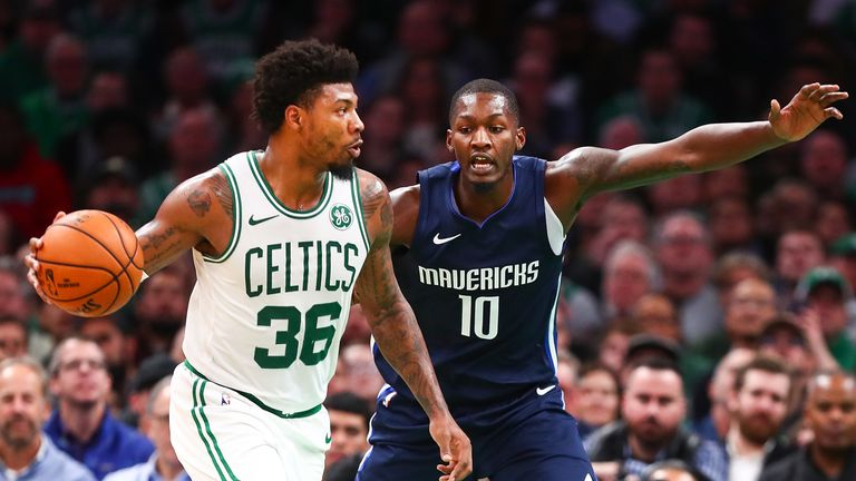 Marcus Smart of the Boston Celtics drives to the basket while guarded by Dorian Finney-Smith of the Dallas Mavericks