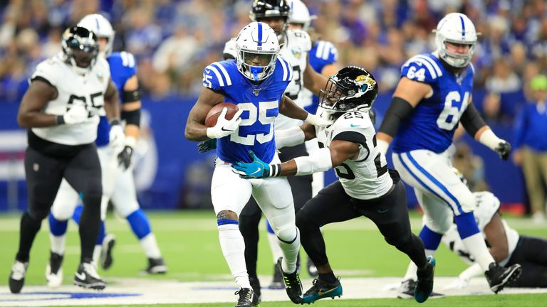 Indianapolis Colts running back Marlon Mack holds off Jacksonville Jaguars cornerback D.J. Hayden
