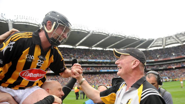 Martin Comerford celebrates the 2009 All-Ireland final win over Tipperary with Brian Cody