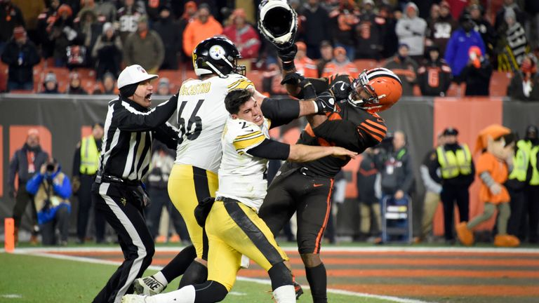 Steelers quarterback Mason Rudolph clashes with Browns defensive end Myles Garrett