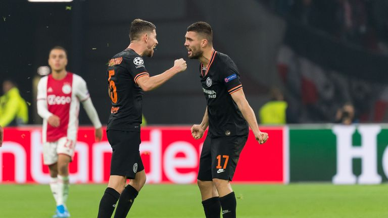 Chelsea midfielders Jorginho and Mateo Kovacic celebrate winning at Ajax