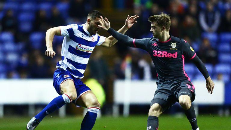 Matt Miazga of Reading is tackled by Patrick Bamford of Leeds United