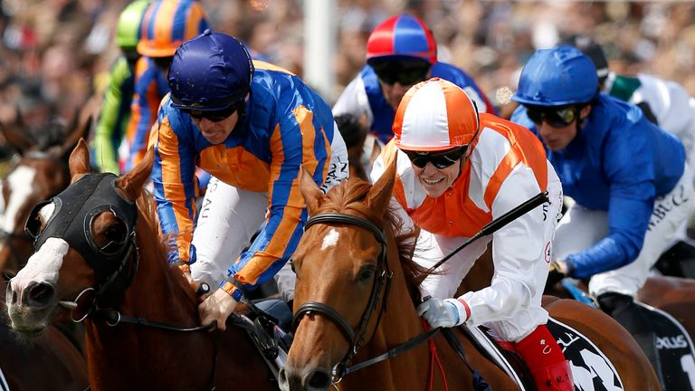 Craig Williams rides Vow and Declare (orange and white) to victory in the 2019 Melbourne Cup