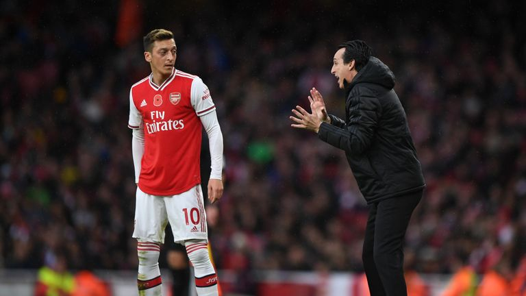 Unai Emery issues instructions to Mesut Ozil during Arsenal's game against Wolves at the Emirates Stadium
