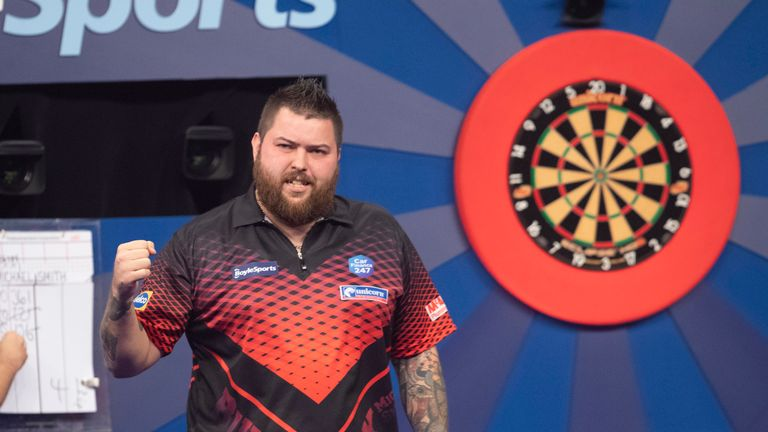 Michael Smith was in scintillating form to book his place in the last 16