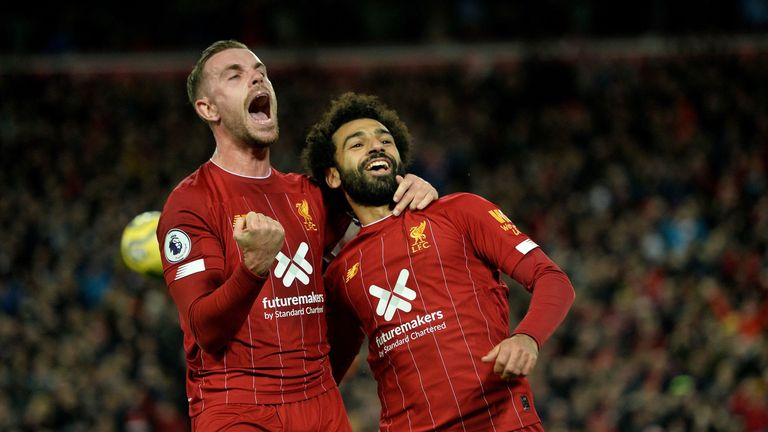 Jordan Henderson and Mohamed Salah celebrate Liverpool's win over Manchester City