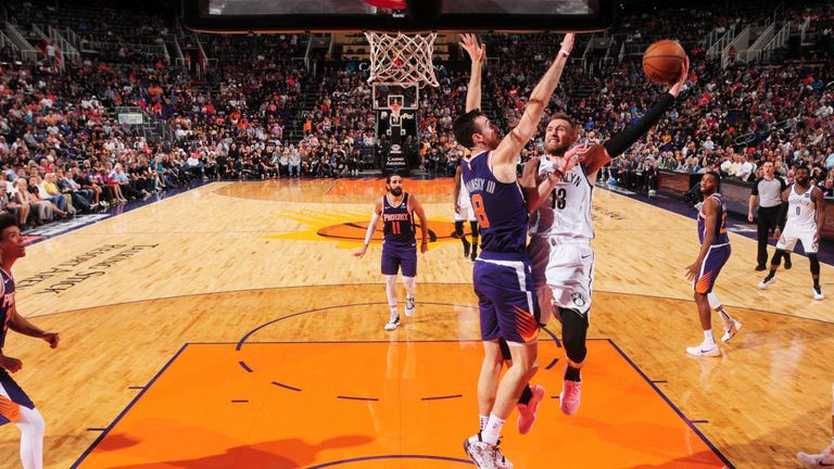 Dzanan Musa of the Brooklyn Nets drives to the basket during a game against the Phoenix Suns