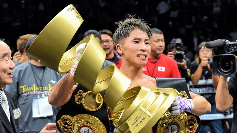 Naoya Inoue lifts the Muhammad Ali trophy after win over Nonito Donaire