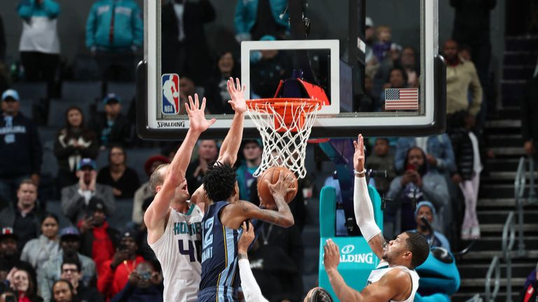 Ja Morant #12 of the Memphis Grizzlies shoots the ball to win the game against the Charlotte Hornet