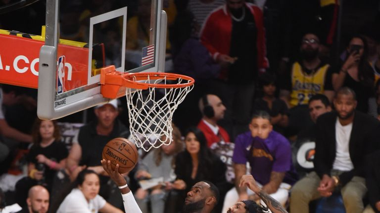 LeBron James drives to the basket for a layup against the Hawks
