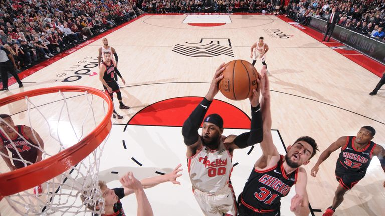 Carmelo Anthony evades two Chicago Bulls defenders to power to the basket in another impressive scoring performance for the Trail Blazers