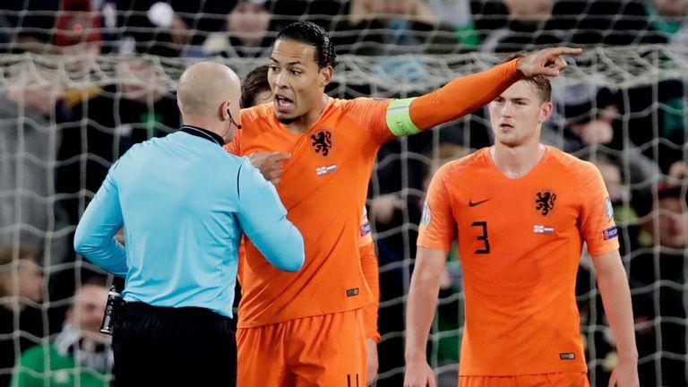 Netherlands captain Virgil van Dijk protests against the Northern Ireland penalty
