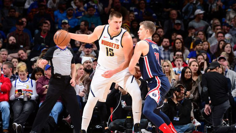 DENVER, CO - NOVEMBER 26: Nikola Jokic #15 of the Denver Nuggets handles the ball against the Washington Wizards on November 26, 2019 at the Pepsi Center in Denver, Colorado. NOTE TO USER: User expressly acknowledges and agrees that, by downloading and/or using this Photograph, user is consenting to the terms and conditions of the Getty Images License Agreement. Mandatory Copyright Notice: Copyright 2019 NBAE (Photo by Bart Young/NBAE via Getty Images)