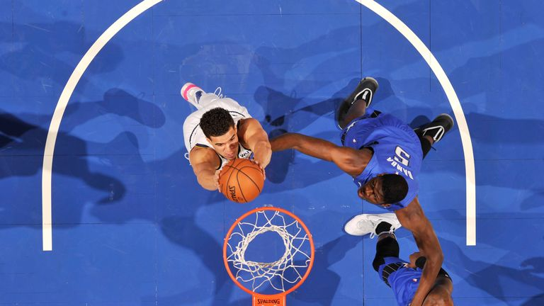 Michael Porter Jr. of the Denver Nuggets goes up for a dunk against the Orlando Magic