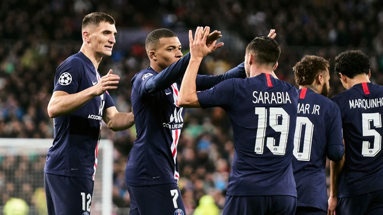 Quick-fire goas earned PSG a 2-2 draw with Real