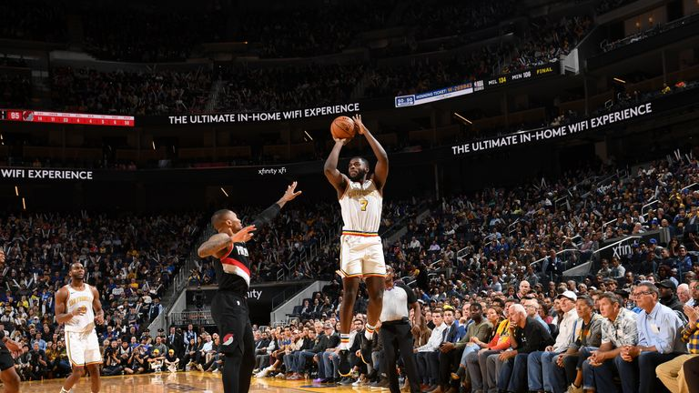 Eric Paschall of the Golden State Warriors shoots the ball against the Portland Trail Blazers