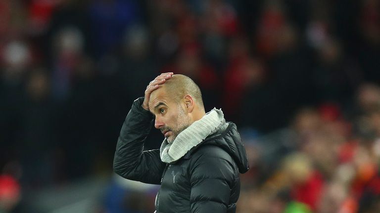 A dejected Pep Guardiola during Liverpool vs Manchester City at Anfield