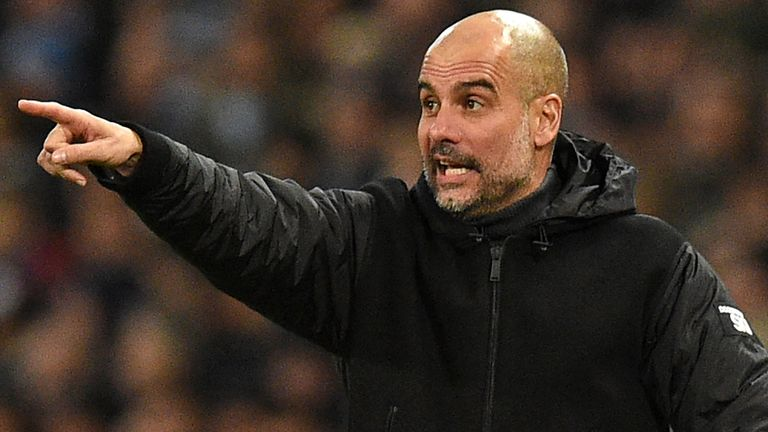 Pep Guardiola gesticulates from the touchline during Manchester City's 2-1 win against Chelsea