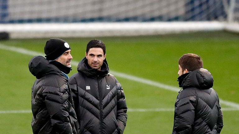 Pep Guardiola with assistant Mikel Arteta during a training session at the City Football Academy